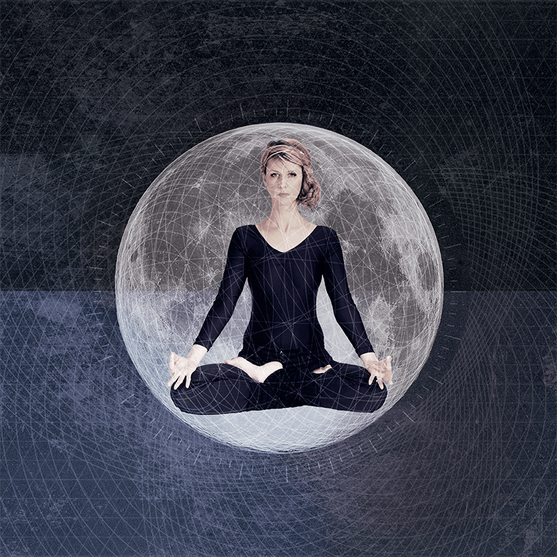 In-between book-your-warrior-guide - Julie Mcguire sits in a yoga pose